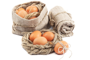Eggs in canvas sack isolated on a white background.