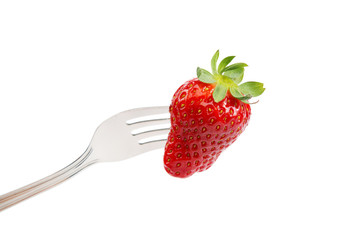 Fresh strawberry on a fork on white background.