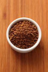 Instant coffee granules in a bowl