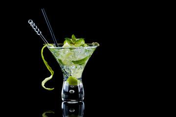 Fresh Lime Mojito over black background