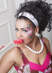 woman makeup with flower and candy