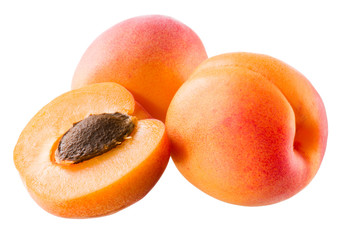 Three apricots on white