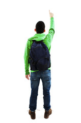 Young student with backpacks pointing at wall. Back view