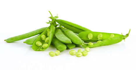 Fresh green peas isolated over white