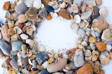 Frame of sea shells and stones