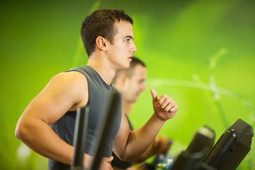Man jogging in a gym