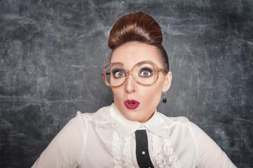 Surprised teacher with eyeglasses