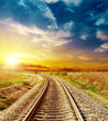 good sunset in colored sky over railroad - 69416574