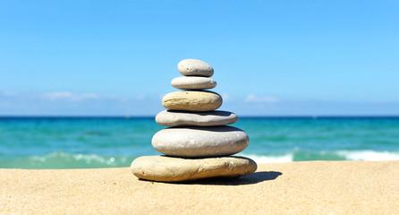 Pyramid of stones, beach, zen