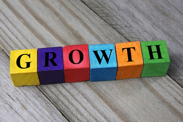 word growth on wooden colorful cubes