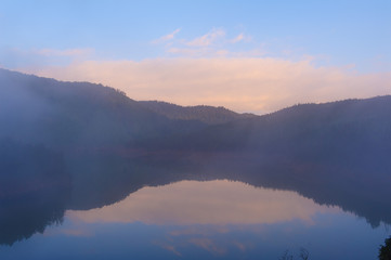 Lake with mist in morning