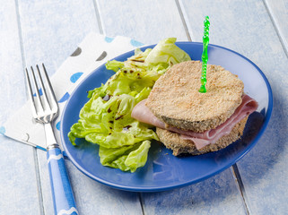 eggplant sandwich stuffed with ham and lettuce salad