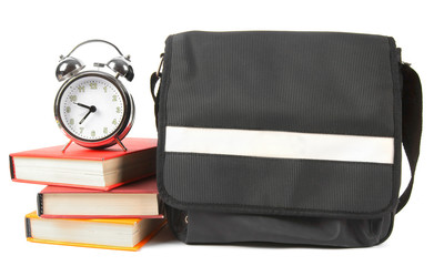 School backpack, books and alarm clock.