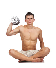 Bodybuilder sitting with dumbbell