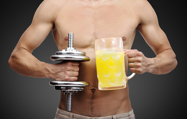 dumbbell and mug with juice