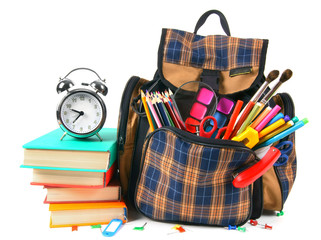 Books, school accessories and a backpack.