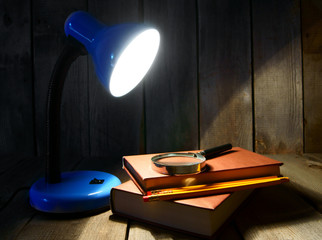 The fixture, books and a magnifier.