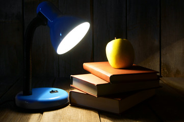 Books, an apple and the fixture.
