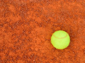 Tennis Ball on clay background