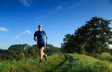 Man trail running in the countryside