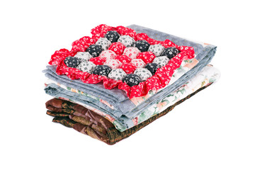 Stack of beautiful handmade quilts.