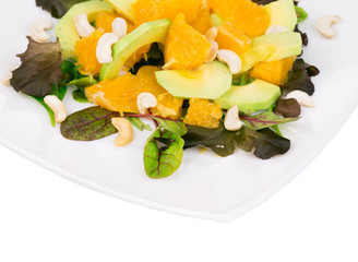 Fitness salad with avocado and cashew.