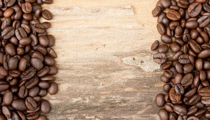 Background with coffee beans and wood texture