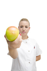 Young female doctor holding an apple