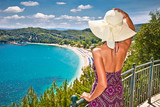 Fototapety Beautiful woman looking on Valtos beach near Parga, Greece.