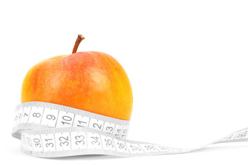 Apples measured the meter on a white