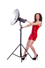 Woman in red dress posing in the studio