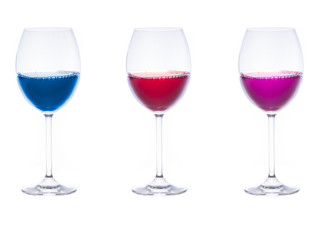 Three glasses with colorful liquids inside