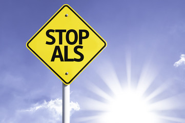 Stop ALS road sign with sun background