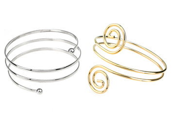 silver and golden bracelets isolated on white background