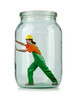 Man in coveralls imprisoned in glass jar
