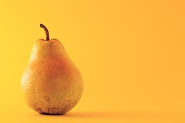 Beautiful ripe yellow pear on yellow background