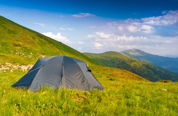 Tourists tent in mountains