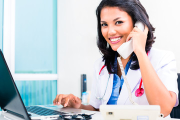 Asian doctor in office administration work