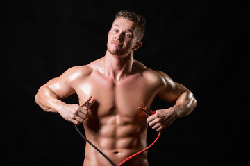athlete holds the high voltage wires.
