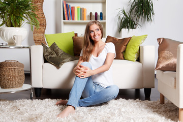 Beautiful young woman relaxing in the living room