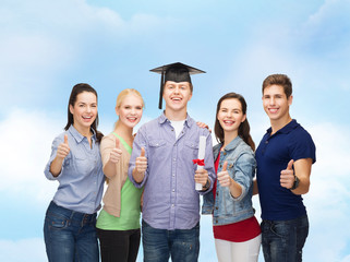 group of students with diploma showing thumbs up
