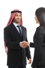 Arab saudi happy businessman handshaking in a negotiation