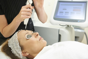 Beautician Carrying Out Q Switch Laser Treatment