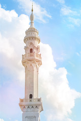 White mosque with a minaret on the sky with clouds. (Bulgaria)
