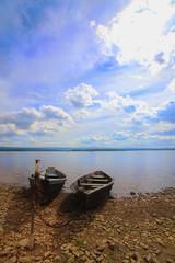 wooden oar boats on bank of lake