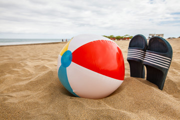 Ball with slipper on the beach