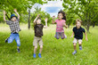 Kids Jumping in a orchard