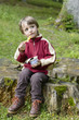 Boy Eating in forest