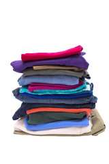 Big Stack Of Folded Clothes Isolated On White