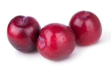 three juicy ripe plums